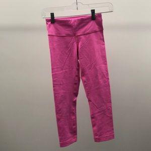 lululemon athletica Pants - Lululemon bright pink Wunder under crops sz 2